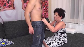 Short haired granny, Klotild and a young guy, Rob are having sex, on the sofa
