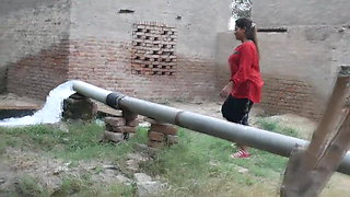 Desi Indian girl bathing in pool, village girl taking bath