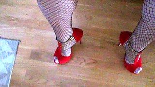 Crossdressing and masturbating  in skirt, fishnets and heels
