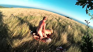 Buxom blonde takes a dick for a wild ride in the outdoors