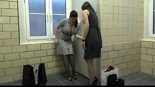 Two mature found a hole in public toilette