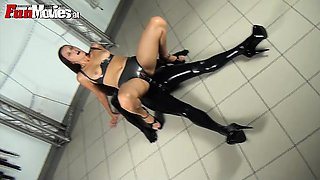 Hotie rides a dildo wearing living latex sex toy