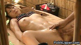 Asian doll has a massage on the beach