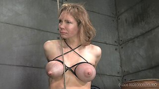Blonde slave in bondage refined with massive toy in BDSM