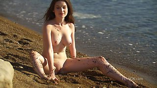 Sexy alone beauty Serena Wood has great time on the beach on her own