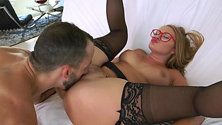 A blonde with glasses and a hot ass is held firmly by her eager man