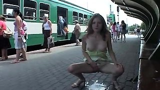 Half-naked teeny squats down to piss at a train station