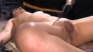 tied-up slave enjoying intense orgasms after brutal punishment