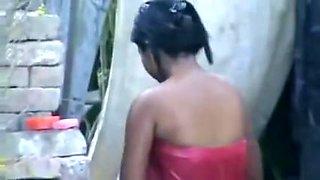 wow... outstanding desi village gal bathing outside