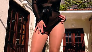 Provocative milf in pantyhose exposes her curves outside
