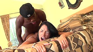 A massive cock is going inside a flawless Latina. She is loving it