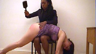 Rubbing her bottom after spanking but before hairbrush spanking