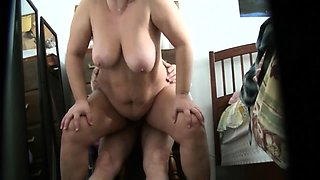 Lustful granny with big breasts rides a dick on hidden cam