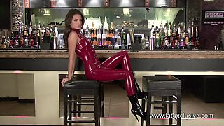 A bit tipsy alone bar chick is ready to look horny while posing in latex stuff
