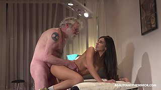 Skinny brunette Angela Allison fucked on the table by an older guy