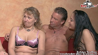 German mature housewife fucks with natural tits at swinger club
