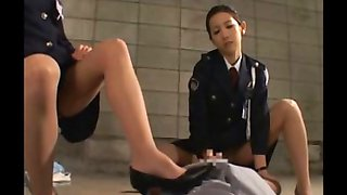Two female asian cops humiliate prisoner