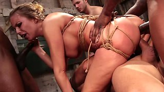 Gangbang video where tied up Britney Amber is double penetrated