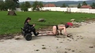 Leather mistress trains slave