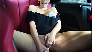 Sultry brunette milf with sexy legs fucks a dildo in the car