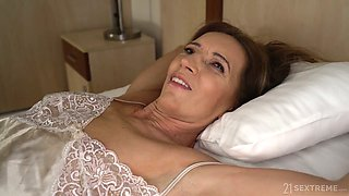 Whorable mature lady in pink dress Viol is fucked doggy rather hard
