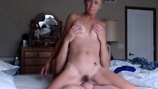 Lustful blonde granny hangs on for a deep fucking on the bed