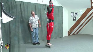 ass hooked bondage doll stretched on tiptoes