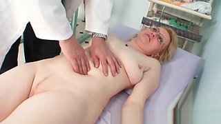 Blond milf wears glasses and get milky exam