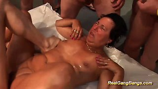 oiled stepmom in her first gangbang