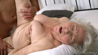 Old and insatiable lady gets herself a boytoy and she loves to fuck a lot