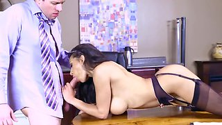 Slutty secretary sucks cock on office desk