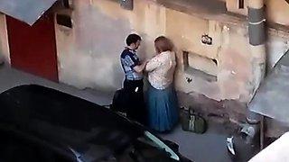 Street voyeur shoots a cute babe getting nailed doggystyle