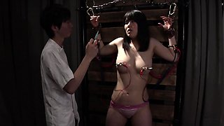 Busty Japanese teen with sexy legs gets schooled in bondage