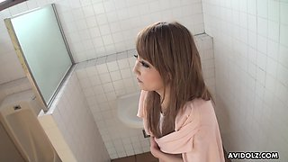 Japanese passenger Michiru gives a blowjob in a public toilet