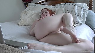 Chubby redhead teases with her pussy and plays with her toys