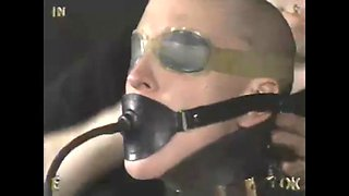 Slave shaved and trained in latex