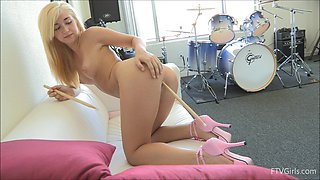 Jayde shoves drum sticks up her ass and pink pussy